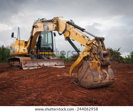 WENTWORTH, CANADA - SEPTEMBER 02, 2014: Caterpillar excavator on site. Caterpillar is the world's leading producer of construction equipment including engines,turbines and diesel-electric locomotives. - stock photo