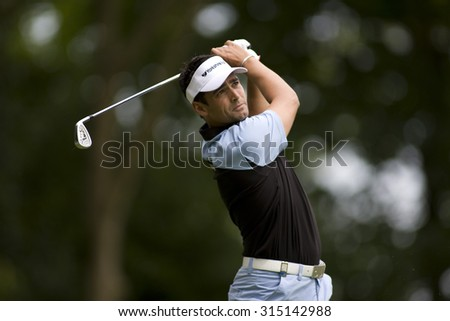 WENTWORTH, ENGLAND. 23 MAY 2009.Lee SLATTERY ENG  playing a shot during the 3rd round of the European Tour BMW PGA Championship. - stock photo