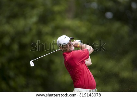 WENTWORTH, ENGLAND. 23 MAY 2009.Mark Warren playing in the 3rd round of the European Tour BMW PGA Championship. - stock photo
