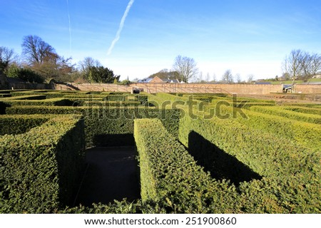 WENTWORTH, UK - FEBRUARY 8 2015: The historic gardens of Wentworth Woodhouse is set within the extensive former kitchen gardens and features a complete redesign and replanting of the Millennium Maze - stock photo