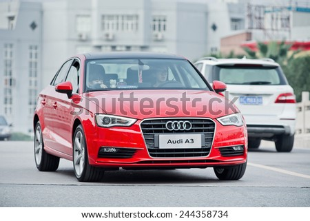 WENZHOU-CHINA-NOV. 17, 2014. New Audi A3 on the street. German Audi, BMW and Mercedes-Benz maintain a solid grip on China's luxury car market, sell most of their models for more than 300,000 yuan. - stock photo