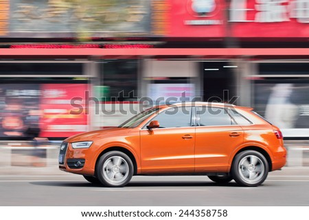 WENZHOU-CHINA-NOV. 19, 2014. New Audi Q3 on the street. German Audi, BMW and Mercedes-Benz maintain a solid grip on China's luxury car market, sell most of their models for more than 300,000 yuan. - stock photo
