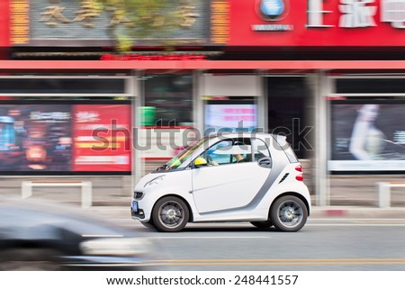 WENZHOU-CHINA-NOV. 19, 2014. Smart rushes trough city center. According chief executive Annette Winkler China might overtake Germany and Italy to become the biggest market for Smart within few years.