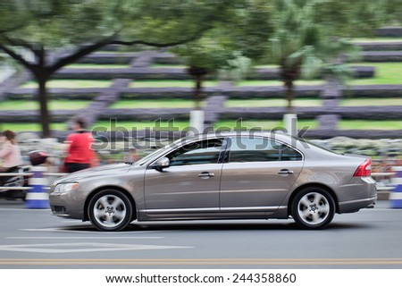 WENZHOU-CHINA-NOV. 19, 2014. Volvo S80L on the street. Volvo will become the first major global automaker to export cars from China to the United States, the company has announced on January 12, 2015. - stock photo