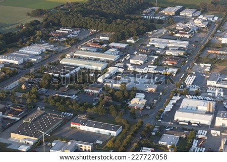 WESEL, GERMANY - SEPTEMBER 9, 2012: Aerial view of industrial park Wesel-Ost I. Many companies in the sectors foods, medical engineering and computer have settled down in this industrial district.  - stock photo