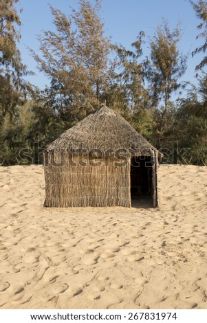 West-African typical hut with a straw roof  West-African typical hut with a straw roof  - stock photo