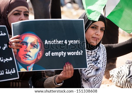 WEST BANK, PALESTINIAN TERRITORY - MARCH 20: Palestinian activists protest the visit of U.S. President Barack Obama, West Bank, March 20, 2013. - stock photo