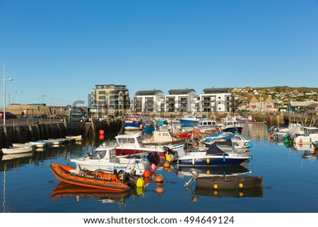 WEST BAY, DORSET, UK-SEPTEMBER 22nd 2016:  Fine calm late summer weather was enjoyed by visitors to West Bay harbour, Dorset, England, UK on Thursday 22nd September 2016