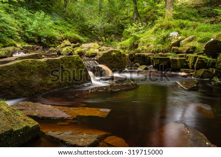 West Beck at Mallyan Spout / Mallyan Spout waterfall at Goathland in the North York Moors National Park flows into West Beck which has created a deep gorge - stock photo