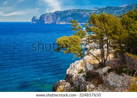 west coastline of Mallorca with its pine trees and mountains - stock photo