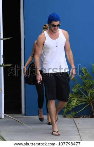 WEST HOLLYWOOD - JUL 13: Miley Cyrus, Liam Hemsworth leaving a Pilates studio on July 13, 2012 in West Hollywood, California