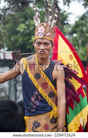 West Kalimantan, Indonesia-February 24, 2013 : The shaman Sticking steels wire into his cheeks. An Extra ordinary performance and ritual during Cap Gomeh celebration in Singkawang,  province.