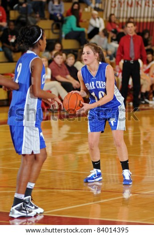 WEST LAWN, PA - DECEMBER 30: Cedar Crest ladies high school basketball player Carly Weaber (#10) thinks about taking a long shot in a game against Perkiomen Valley December 30, 2010 in West Lawn, PA - stock photo