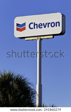 WEST PALM BEACH, FLORIDA - JANUARY 20, 2012: Chevron energy company sign against blue sky in West Palm Beach, Florida. Chevron operates over 3,600 service stations. - stock photo