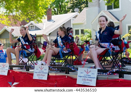 WEST ST. PAUL, MINNESOTA - MAY 21, 2016: Ambassadors for City of Eagan Funfest wave to crowd at annual West St. Paul Days Grande Parade on May 21.  - stock photo
