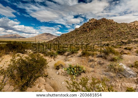 West Texas Landscape of Desert Area with Hills and Blue Sky with Clouds. - stock photo