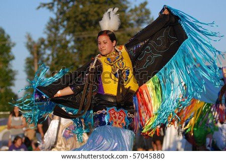 WEST VANCOUVER, BC, CANADA - JULY 10: Native Indian women dance during annual Squamish Nation Pow Wow on July 10, 2010 in West Vancouver, BC, Canada - stock photo