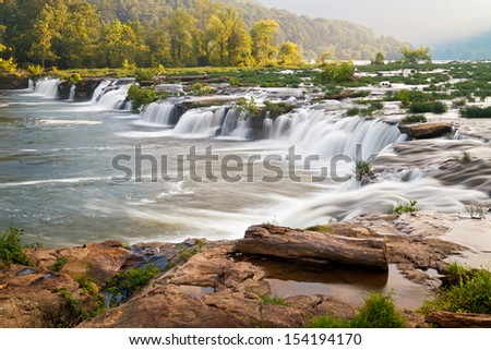 West Virginia's New River, a national scenic river, tumbles over a very wide and very beautiful waterfall near Hinton called Sandstone Falls - stock photo