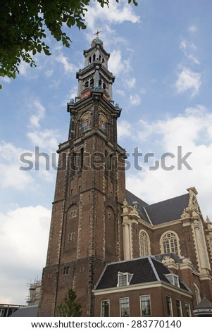 Westerkerk (Western Church) is a Dutch Protestant church in central Amsterdam in the Netherlands. It is next to Amsterdam's Jordaan district, on the bank of the Prinsengracht canal. - stock photo