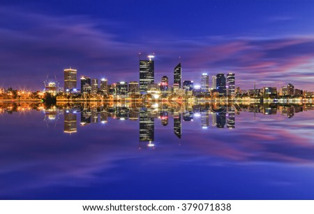 Western Australia capital city Perth CBD at sunrise reflecting in still waters of swan river