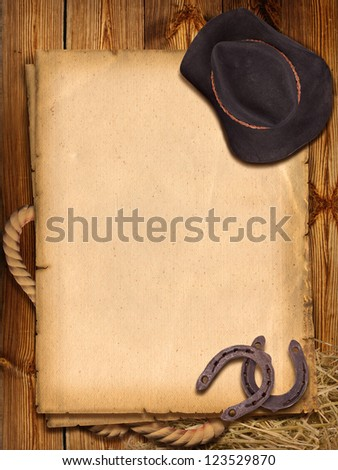 Western background with cowboy hat and horseshoes for design - stock photo