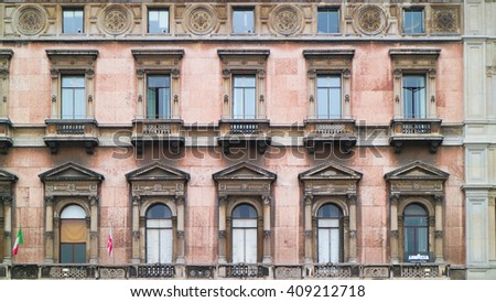 western building's windows , milan italy