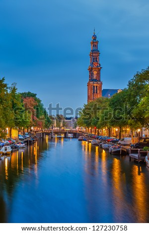 Western church on Prinsengracht canal in Amsterdam - stock photo