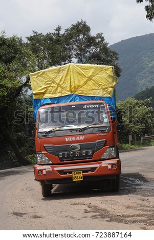 WESTERN GHATS, INDIA - SEP 22, 2017 -Decorated truck on mountain road through the Western Ghats, Karnataka, India