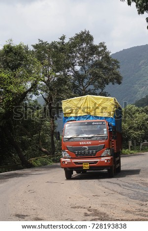 WESTERN GHATS, INDIA - SEP 22, 2017 - Decorated truck on mountain road through the Western Ghats, Karnataka, India
