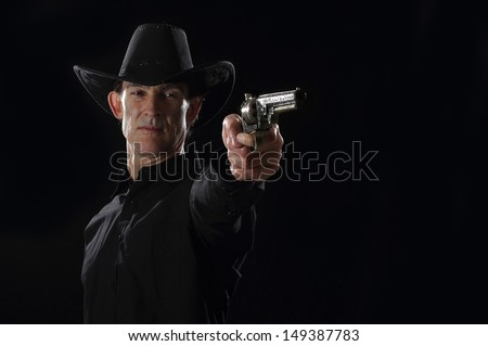 Western gunfighter on a dark background