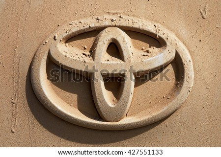 WESTERN MONGOLIA, MONGOLIA - AUG 5, 2011: Rear car with logo of Toyota full of dust traveling in Mongolian desert
