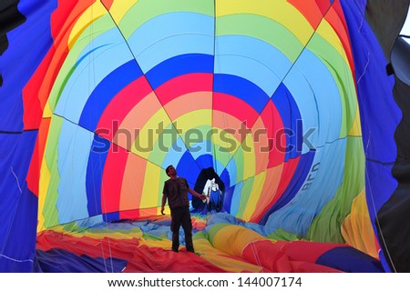 WESTERN NEGEV, ISR - MAR 04:Man inside an hot air balloons on March 04 2010.The largest hot air balloon is the Energizer Bunny Hot Hare Balloon measuring 166 feet tall.