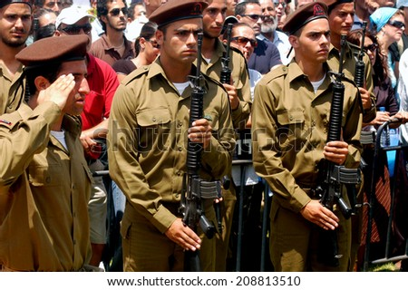 WESTERN NEGEV, ISRAEL - JULY 7 2006: Israeli soldiers. IDF is one of Israeli society's most prominent institutions, influencing the country's economy, culture and political scene. - stock photo