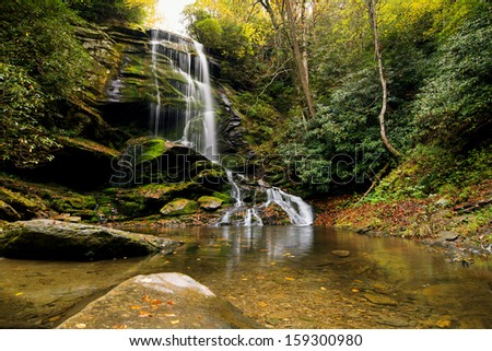 Western North Carolina Waterfall by the name of Catabwa Falls near Asheville, North Carolina - stock photo