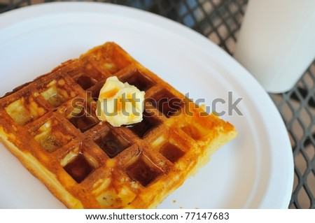 Western style waffle pancake with butter and delicious syrup for breakfast. - stock photo