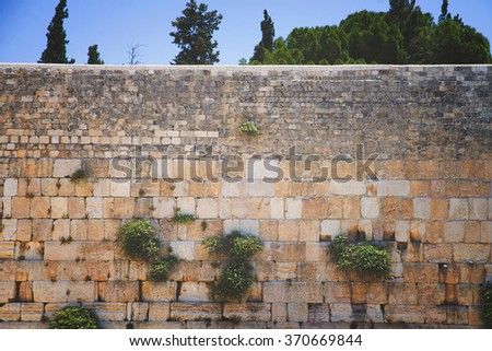 Western Wall against the blue sky - stock photo
