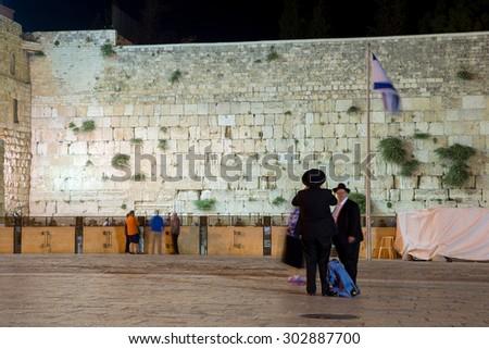 Western Wall in Jerusalem at night - stock photo