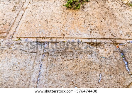 Western Wall or Kotel detail, is located in the Old City of Jerusalem at the foot of the western side of the Temple Mount. - stock photo