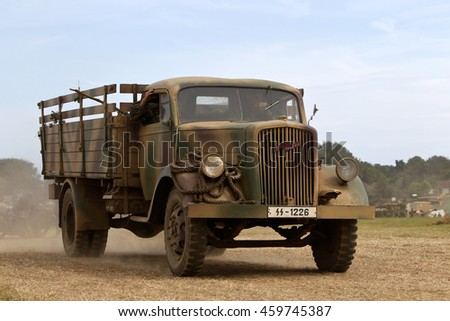 WESTERNHANGER, UK - JULY 21: A vintage WW2 Opel Blitz truck parades around the arena for the public to watch at the War & Peace Revival show on July 21, 2016 in Westernhanger