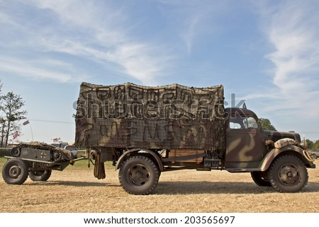 WESTERNHANGER, UK - JULY 17: A WW2 German army service wagon, with Goliath land mine in tow, heads toward the main show arena at the War & Peace show on July 17, 2013 in Westernhanger