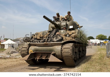 WESTERNHANGER, UK - JULY 17: A WW2 Sherman tank leaves the main arena having just participated in a battle re-enactment for the public at the War & Peace show on July 17, 2013 in Westernhanger