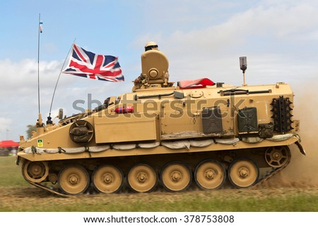 WESTERNHANGER, UK - JULY 22: An ex British army Alvis Stormer is driven around the main show arena for the public to view at the War & Peace show on July 22, 2015 in Westernhanger