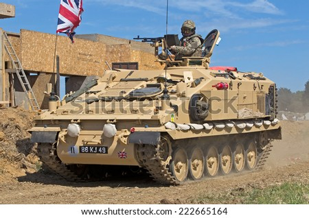 WESTERNHANGER, UK - JULY 16: An ex British army APC with authentic turret gunner is displayed in the main arena at the War & Peace show on July 16, 2014 in Westernhanger - stock photo