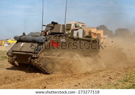 WESTERNHANGER, UK - JULY 18: An ex M113 Bradley armoured troop carrier is driven around the main arena for the public to watch at the W&P show on July 18, 2014 in Westernhanger - stock photo