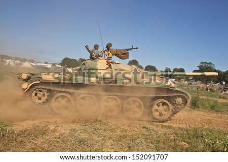 WESTERNHANGER, UK - JULY 18: An ex Russian T55 MBT exits a tank trap in the W&P arena during a display for the public on July 18, 2013 in Westernhanger