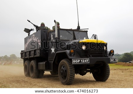 WESTERNHANGER, UK - JULY 20: An ex US army gun lorry leaves the main arena having completed a Vietnam war re-enactment battle for the public to watch at the W&P show on July 20, 2016 in Westernhanger