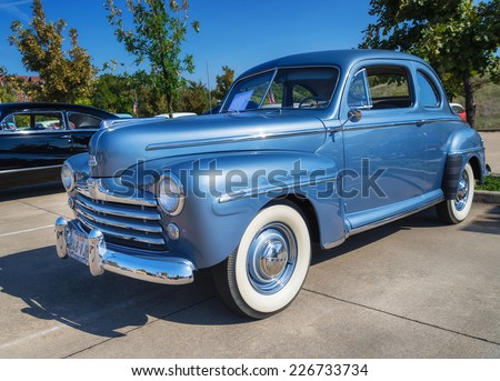 WESTLAKE, TEXAS - OCTOBER 18, 2014: A blue 1948 Ford Super Deluxe Coupe is on display at the 4th Annual Westlake Classic Car Show. Front side view.