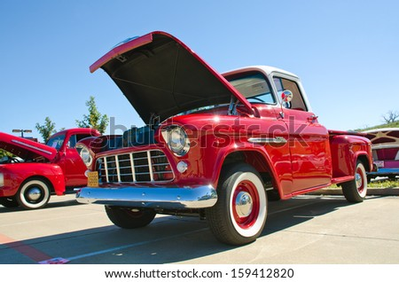 WESTLAKE, TEXAS - OCTOBER 19: A 1955 Chevrolet pickup truck is on display at the 3rd Annual Westlake Classic Car Show on October 19, 2013 in Westlake, Texas. - stock photo