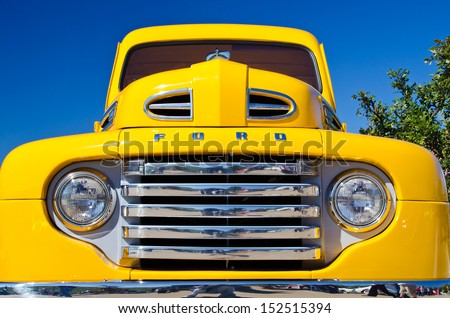 WESTLAKE, TEXAS - OCTOBER 27: A 1949 Ford F1 pickup truck is on display at the 2nd Annual Westlake Classic Car Show on October 27, 2012 in Westlake, Texas. Front view details. - stock photo