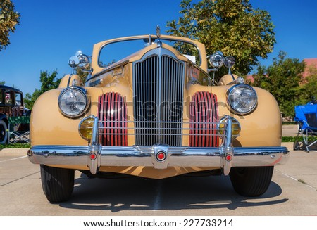 WESTLAKE, TEXAS - OCTOBER 18, 2014: A 1941 Packard 120 (One-Twenty) Convertible Sedan is on display at the 4th Annual Westlake Classic Car Show. Front view.  - stock photo